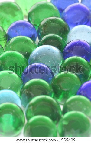 A background of toy marbles created using recycled glass bottles.