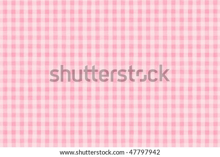 a background texture of pink plaid fabric