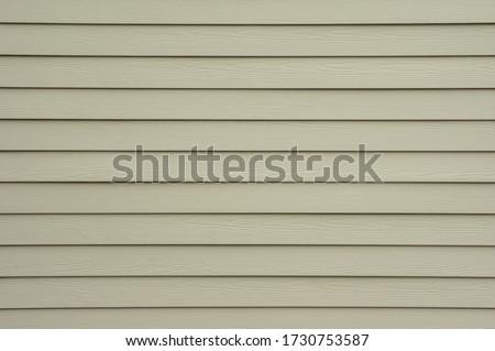 A background wall of tan shiplap siding. Foto stock ©