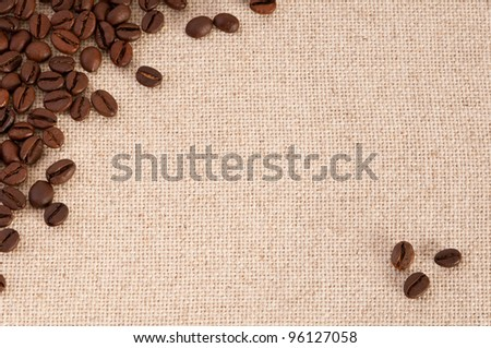 A background with coffee beans on canvas