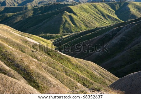 a badlands (also badland) is a type of dry terrain where softer sedimentary rocks and clay-rich soils have been extensively eroded by wind and water