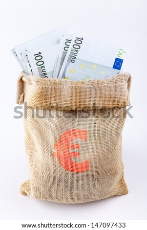 A bag full with 100 euro banknotes with euro sign on the bag isolated on white background