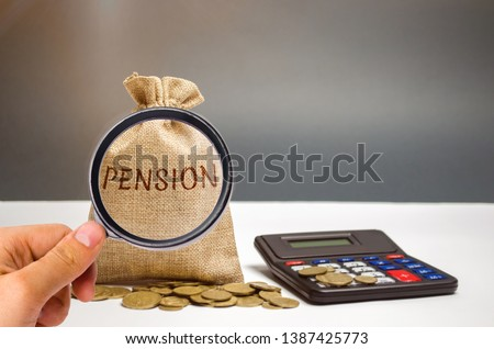 A bag with money and the word Pension and calculator. Pension payments. Help from the state. Accumulation and saving money. Accumulation of pension contributions / enrichment capital. #1387425773