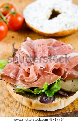 A bagel sandwich with parma ham, cream cheese and tomatoes