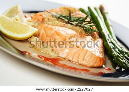 A baked stuffed salmon with asparagus on the side