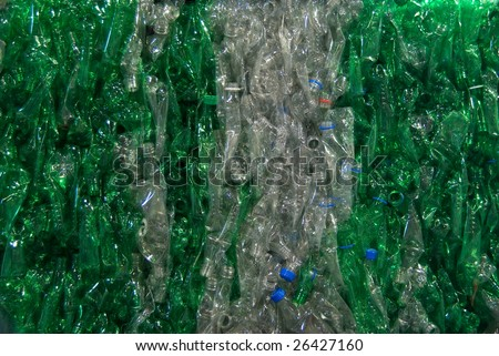 A bale a compressed plastic bottles. They are gathered per type and color.