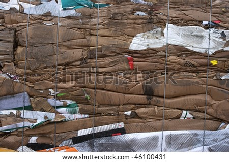 A bale of stacked cardboard for recycling