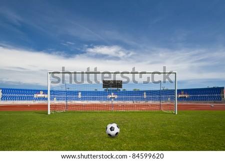 A ball on the green grass of football field