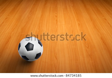 A ball on the wooden floor as background