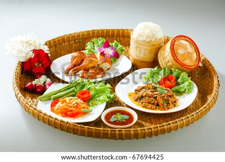 A bamboo tray of Northeast region Thai traditional food style isolated