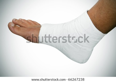 a bandaged foot on a white vignetted background