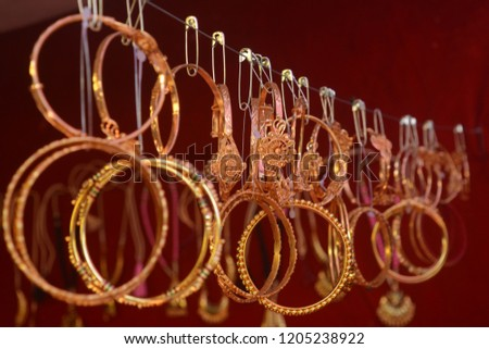 A bangle is one of the most important ornaments that an Indian woman wears. For married women, bangles hold a special significance as they are a sign of their suhaag. #1205238922