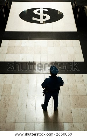 A bank guard with uniform at a bank entrance - stock photo