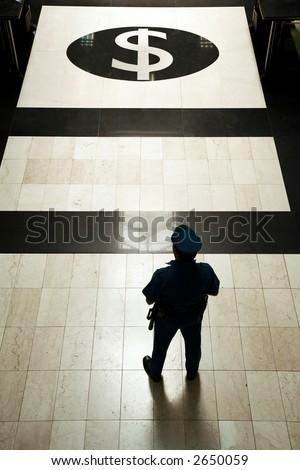 A bank guard with uniform at a bank entrance