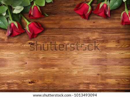 A Banner Template Of Red Roses For Valentines Day Arranged Lying Down On Wooden
