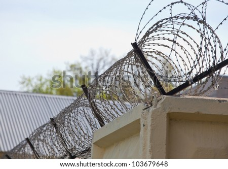 A barbed wire fence on sky