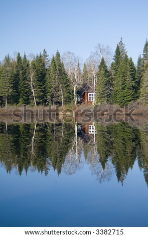 A barely visible fishing cabin on the Mastigouche Nature Reserve in Quebec.