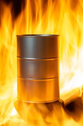 A barrel of oil stands in a bright fire. a barrel of oil surrounded by flames