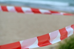 A barrier tape at the beach of Finestrat-Spain. A corona protective action.
