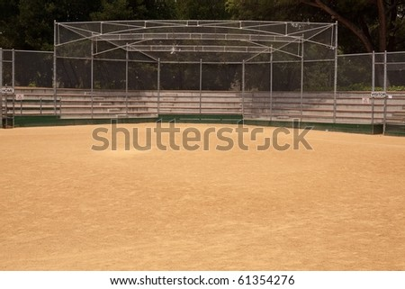 A baseball field, also called a ball field or a baseball diamond, is the field  upon which the game of baseball is played. - stock photo