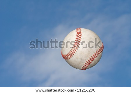 A baseball flies through the air after being hit for the fence.
