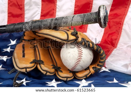 A baseball glove, baseball and bat on an American flag, symbolizing a traditional American sport