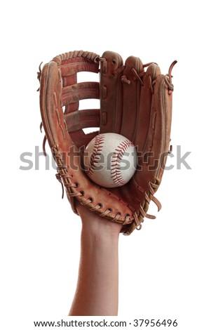 A baseball is caught in a worn baseball glove. - stock photo