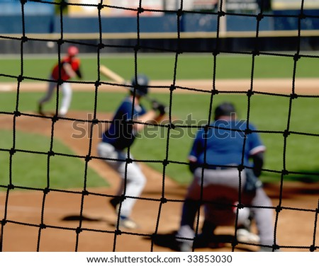 A baseball net protecting viewers from stray balls.