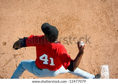 a baseball pitcher throwing a pitch with copy space