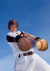 A baseball player taking a swing at a baseball