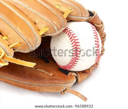 A baseball sits in a mitt.