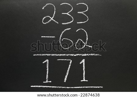A basic subtraction sum written on a blackboard.