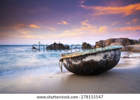 A basket boat at Co Thach beach in early morning, Binh Thuan, Vietnam. Co Thach is famous for the Hang temple, wild nature and the seven-color stone bank.
