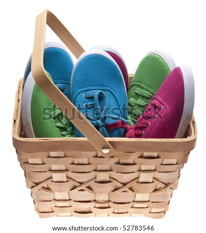 A basket of child sized shoes, concept for giving clothing to the needy.  Isolated on White with a Clipping Path.