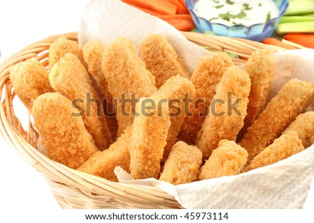 of crispy chicken fingers with platter of vegetables and ranch dip ...