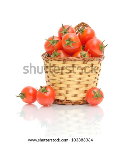 a basket of ripe tomatoes isolated on white close-up of the reflection