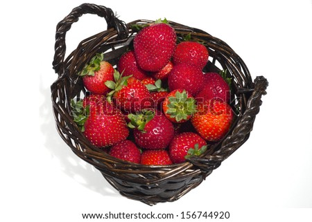 A basket of strawberries on a white background