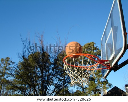 A basketball falling into the hoop for a three-pointer
