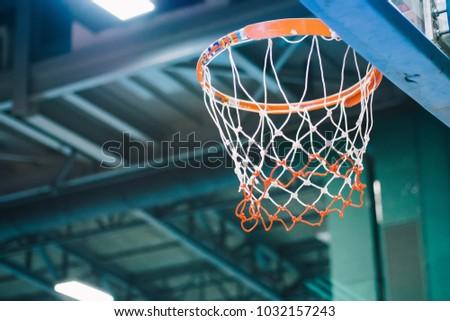 A Basketball hoop and net inside an indoor sport arena