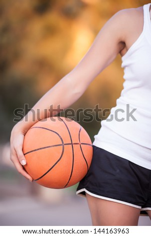 a basketball in his hands, a healthy lifestyle