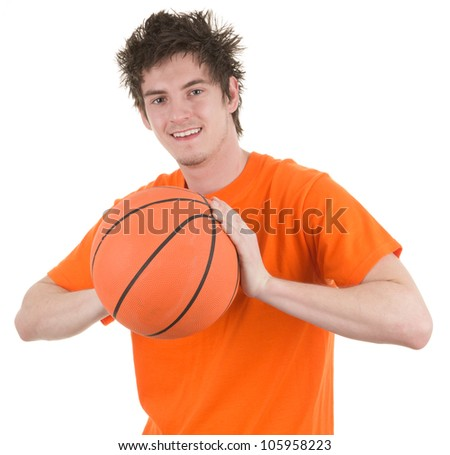 A basketball player holding an orange basketball, isolated on white