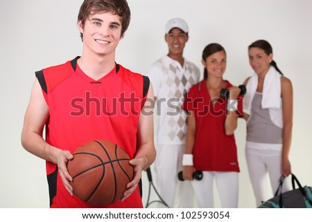 A basketball player posing with other athletes
