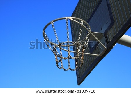 A basketball ring over a blue sky