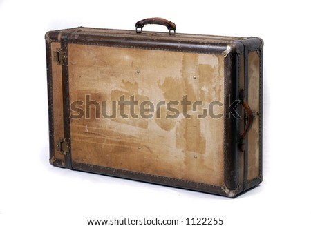 A battered old suitcase shows the traces of luggage labels from world travel