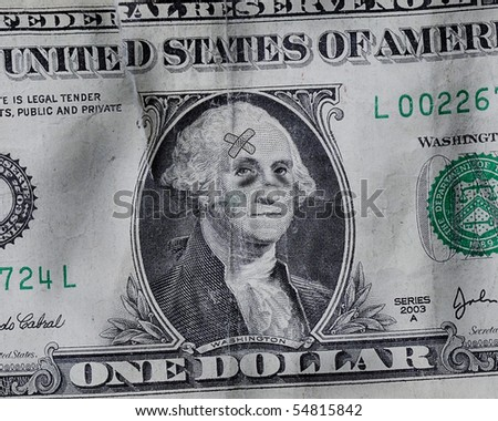 A battered US Dollar where George Washington has black eyes and bandages
