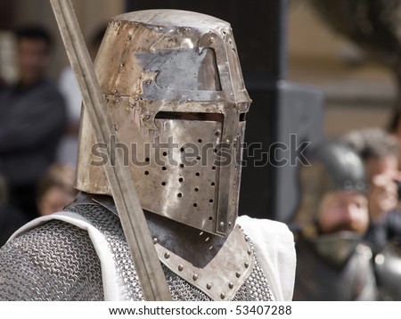 A battle ready medieval crusader in full armour and helmet - stock photo
