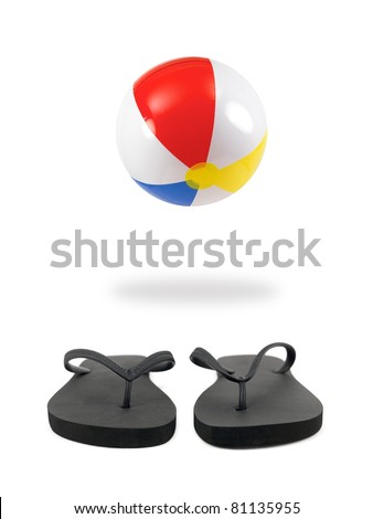 A beach ball and black thongs on white