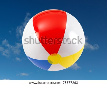 A beach ball in the sky - stock photo