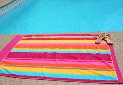 a beach towel poolside