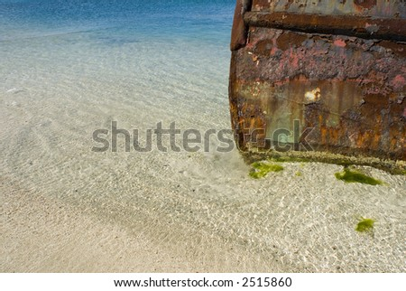 A beached tugboat rusting in the Caribbean.